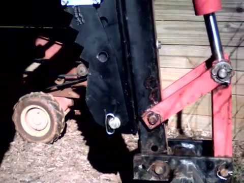 Titan Attachments backhoe thumb on Harbor Freight trencher