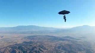 Repeat youtube video GoPro: Erik Roner's Umbrella Skydive