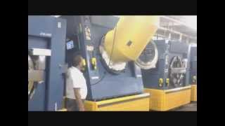 Loading An Open Pocket Tilting Soft Mount Washer-Extractor