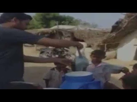 Man distributes free milk to support ongoing farmers protest in Maharashtra