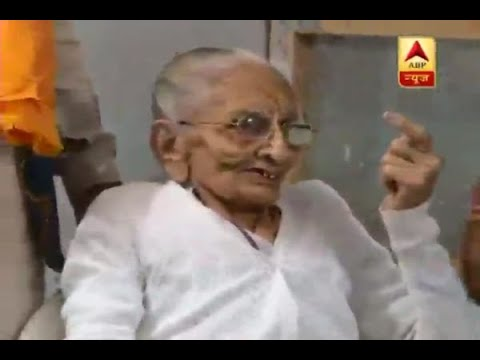 PM Narendra Modi's mother Heeraben Modi poses with inked finger post casting her vote