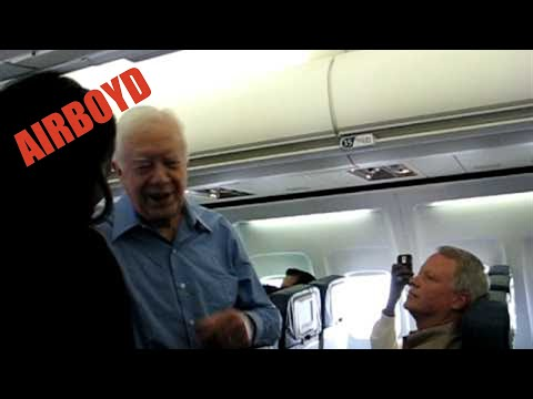 Jimmy Carter Shakes Hands Aboard Commercial Flight