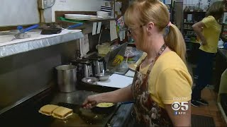 VOLUNTEERS TO THE RESCUE:  A group of volunteers is helping a cafe at the Pleasanton Fairgrounds sta