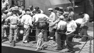USS Trathen (DD-530) approaches and transfers captured Japanese pilot to USS Sang...HD Stock Footage