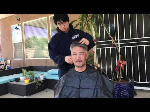 Son Cutting Daddy's Hair