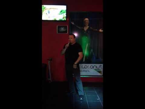 Richard sings at a karaoke bar in Brazil.