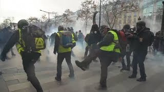 Police fire tear gas and rubber bullets as 31,000 protesters take to the streets across France