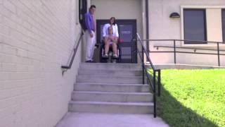 Descending steps with a wheelchair with assistance