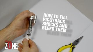 HOW TO PUT OIL INTO YOUR RC's Piggyback Shocks - The O-Zone