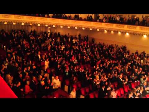Almaty Symphony Orchestra spectators applause and calling for an encore at Carnegia Hall
