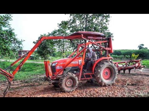 รถไถ  รถแทรกเตอร์ คูโบต้า KUBOTA  ติดตัวคีบ ทำเอง กับงานคีบไม้ยางพารา