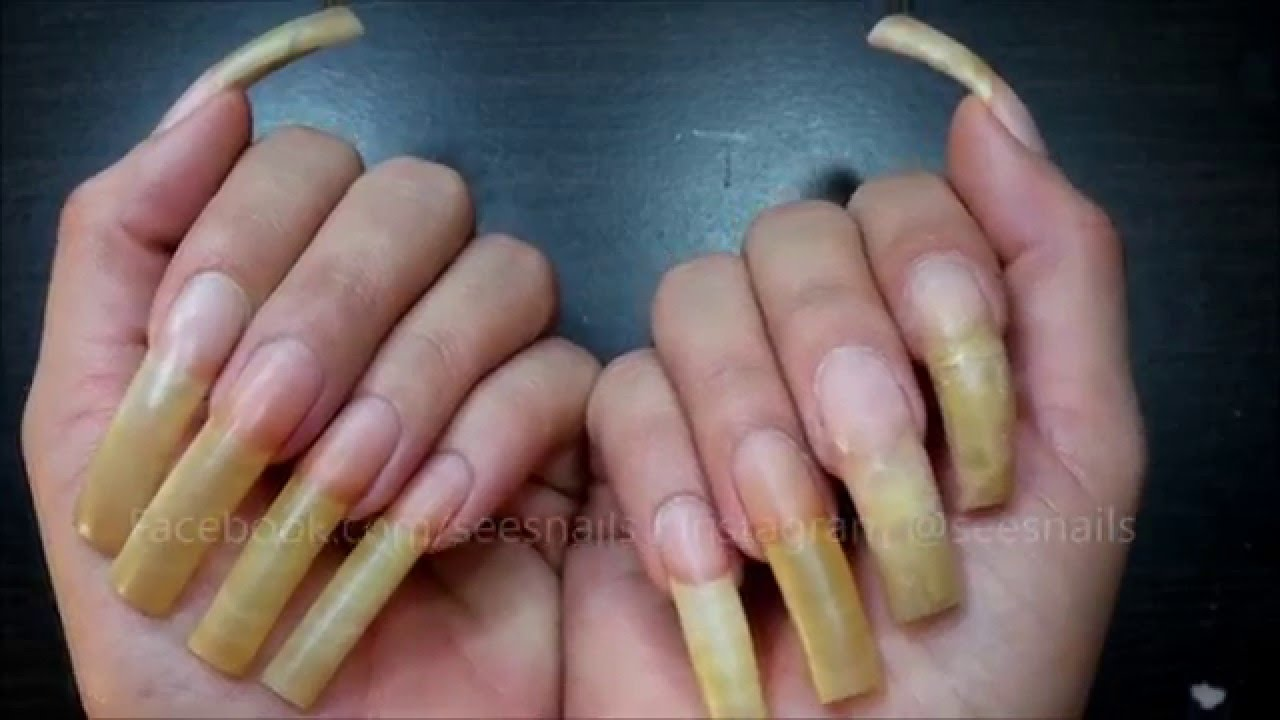 Filing my long natural nails pt. 1 - YouTube