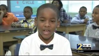 Local elementary school students use bow ties to better themselves