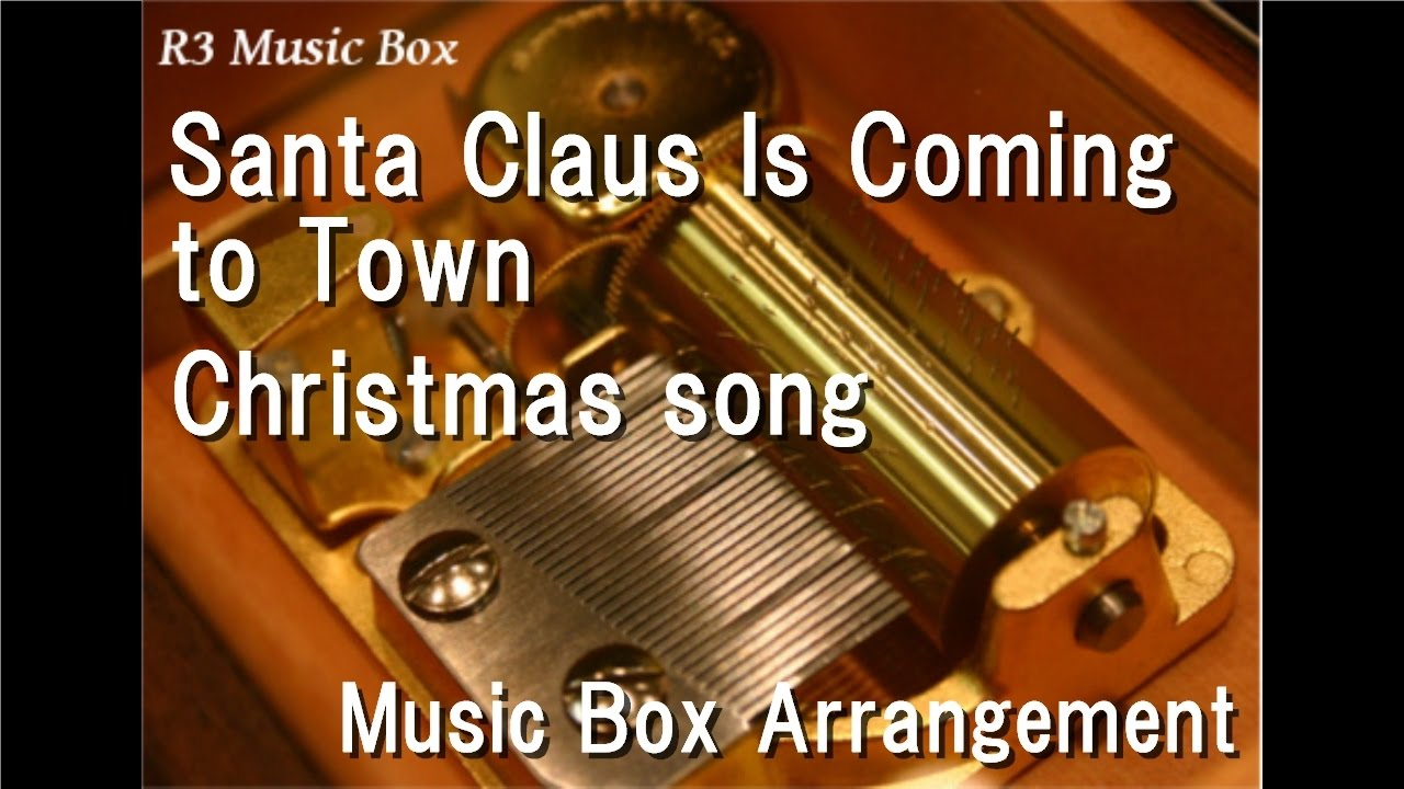 Vintage  Musical  fantasy music  box  Santa in a  lucite  box  Song is  Santa claus  is coming to town