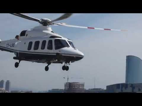 Agusta-Westland AW139 T7-LSS takeoff from Port de Barcelona