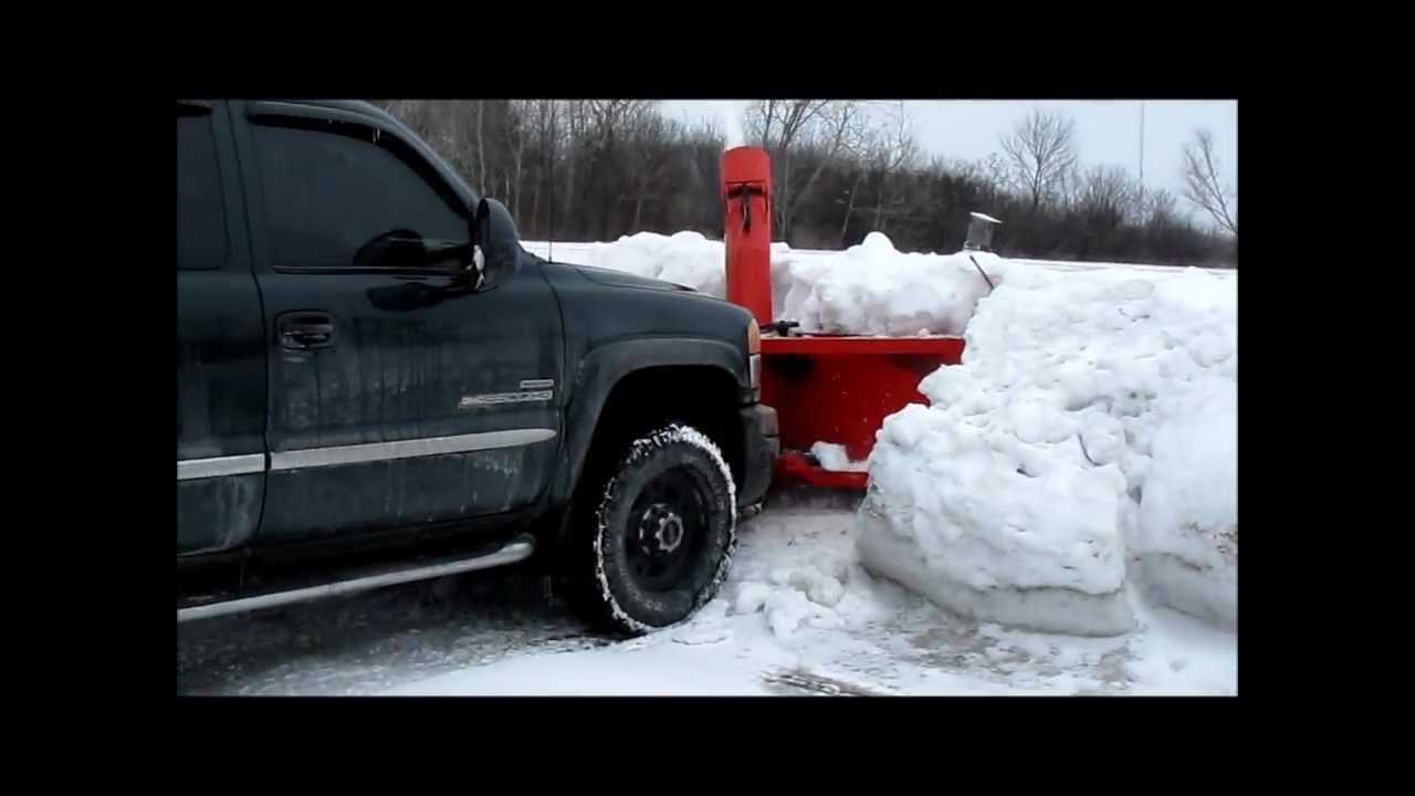 Snow Thrower Truck : Frozen snowbank removal using truck mounted snowblower