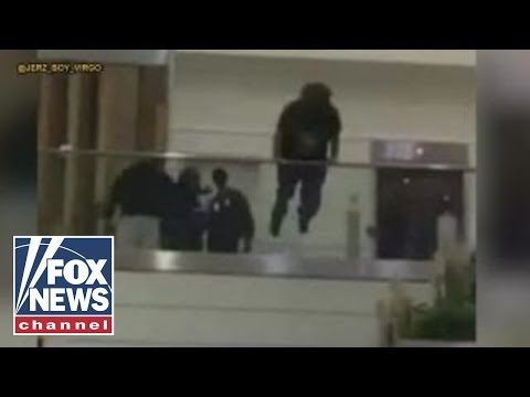 Shocking video: Man jumps over railing at Atlanta airport