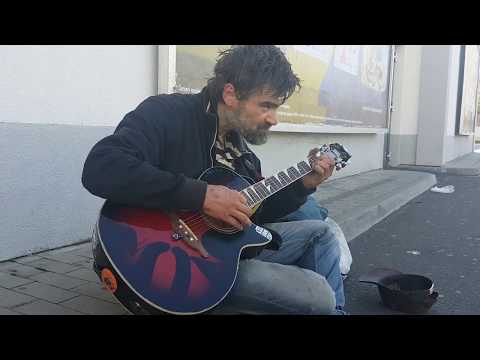 Tomas (homeless) playing Metallica, Hendrix, Alice in Chains, Nirvana in front of supermarket
