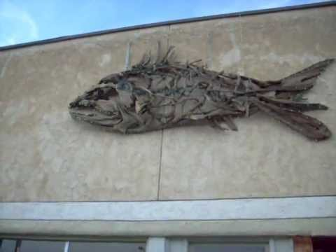 Sculpture: Fish Made Of Driftwood Mounted On Building