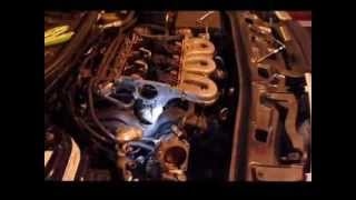 Saturn vue  2002  3.0 v-6 Thermostat removal,  Intake,  valve cover gaskets  and spark plugs