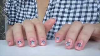 Узор на ногтях цветочки.