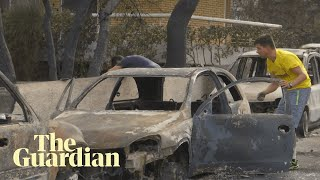 Greek wildfires: 'I took my baby and ran towards the sea'