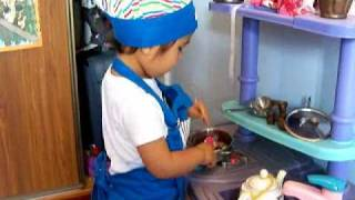 Shiori cooking with chef's hat