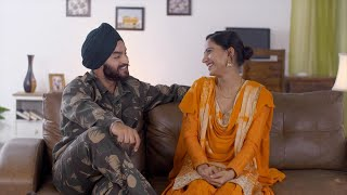 Indian Sikh couple having a nice conversation while sitting on a couch - lifestyle family