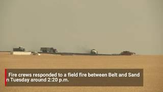 Crews respond to field fire near Belt