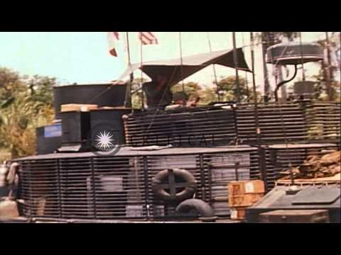 40 mm guns mounted in turret of a Monitor are fired at Viet Cong bunker positions...HD Stock Footage