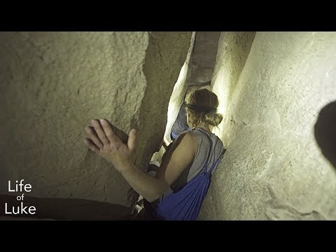 Squeezing through caves under Skaha Bluffs, Penticton
