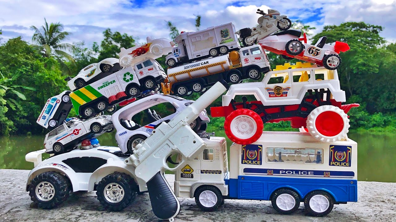 Find some white color toy vehicles, Police Truck, Monster Truck, Motorbike, Sports Car and others