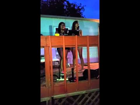 Diana and Natalia singing karaoke