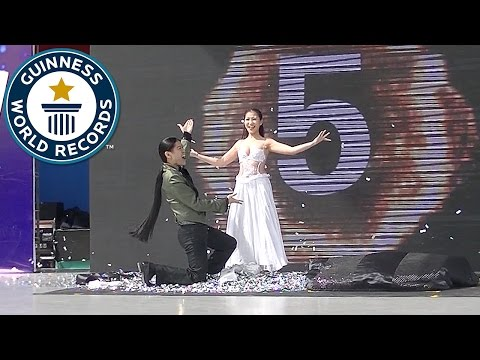 Most costume change illusions in one minute - Guinness World Records