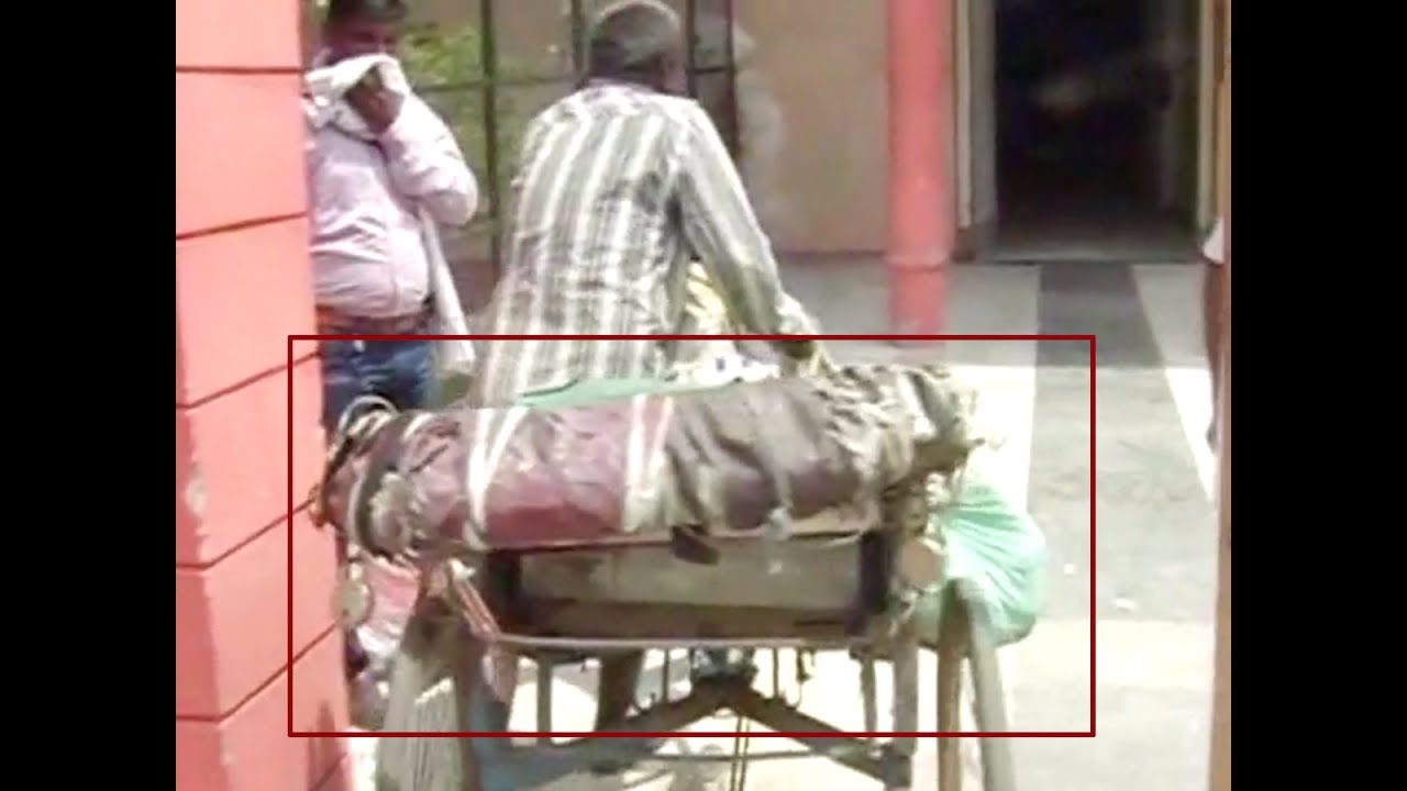 Appalling! Woman's body carried in a rickshaw for post ...