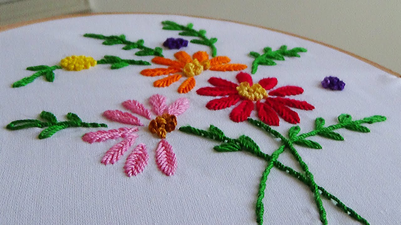 Hand embroidery making flowers with fishbone stitch