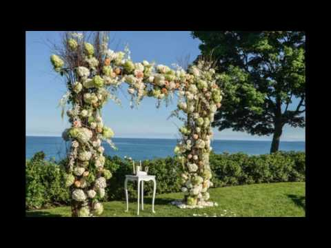 Ceremony Under Wooden Arch with Orange and White Flowers