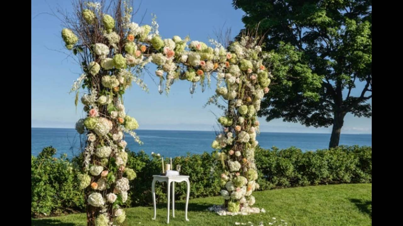 Ceremony under wooden arch with orange and white flowers youtube ceremony under wooden arch with orange and white flowers mightylinksfo