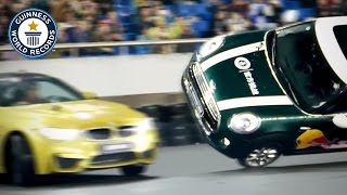 Most donuts (drift spins) around a car driving on two wheels in one minute - Guinness World Records