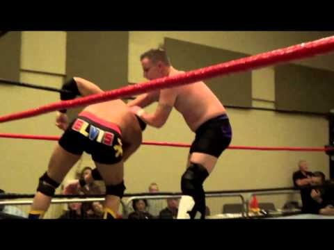 Elvis Aliaga vs. Jack Gamble (Tables Match)