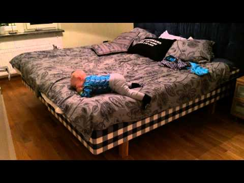 10 Month Old Cute Baby Boy Climbing Out of Bed On His Own