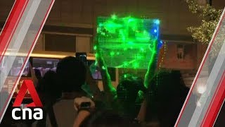 Hundreds attend 'laser' protest at Hong Kong Space Museum