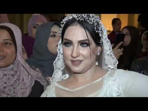 عروسة جميلة جدًا بترقص مع عريسها الشقي في زفة فستيفال