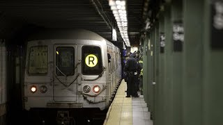 Man falls on subway tracks, survives by diving underneath train
