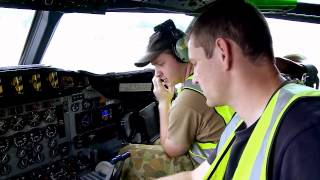 Maintenance crew of RAAF AP-3C Orion Maritime patrol aircraft