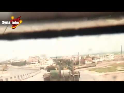 Syrian Arab Army soldiers inside a tank