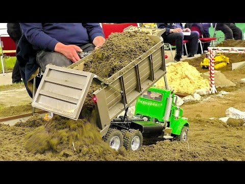 RC 1:16 SCALE MODEL TRUCKS IN MOTION AT THE HARD WORK ON THE RC CONSTRUCTION SITE