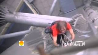 French spiderman Alain Robert scales world's tallest steel tower in Zhengzhou, China