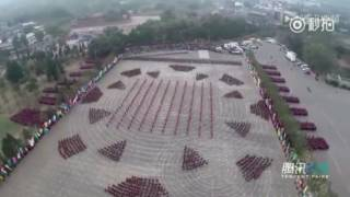 Repeat youtube video Some 30,000 martial arts students perform Kung Fu together at Int'l Shaolin Wushu Festival in China