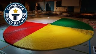 SPOTLIGHT - 50,000 Dominoes Toppled in a Circle Bomb